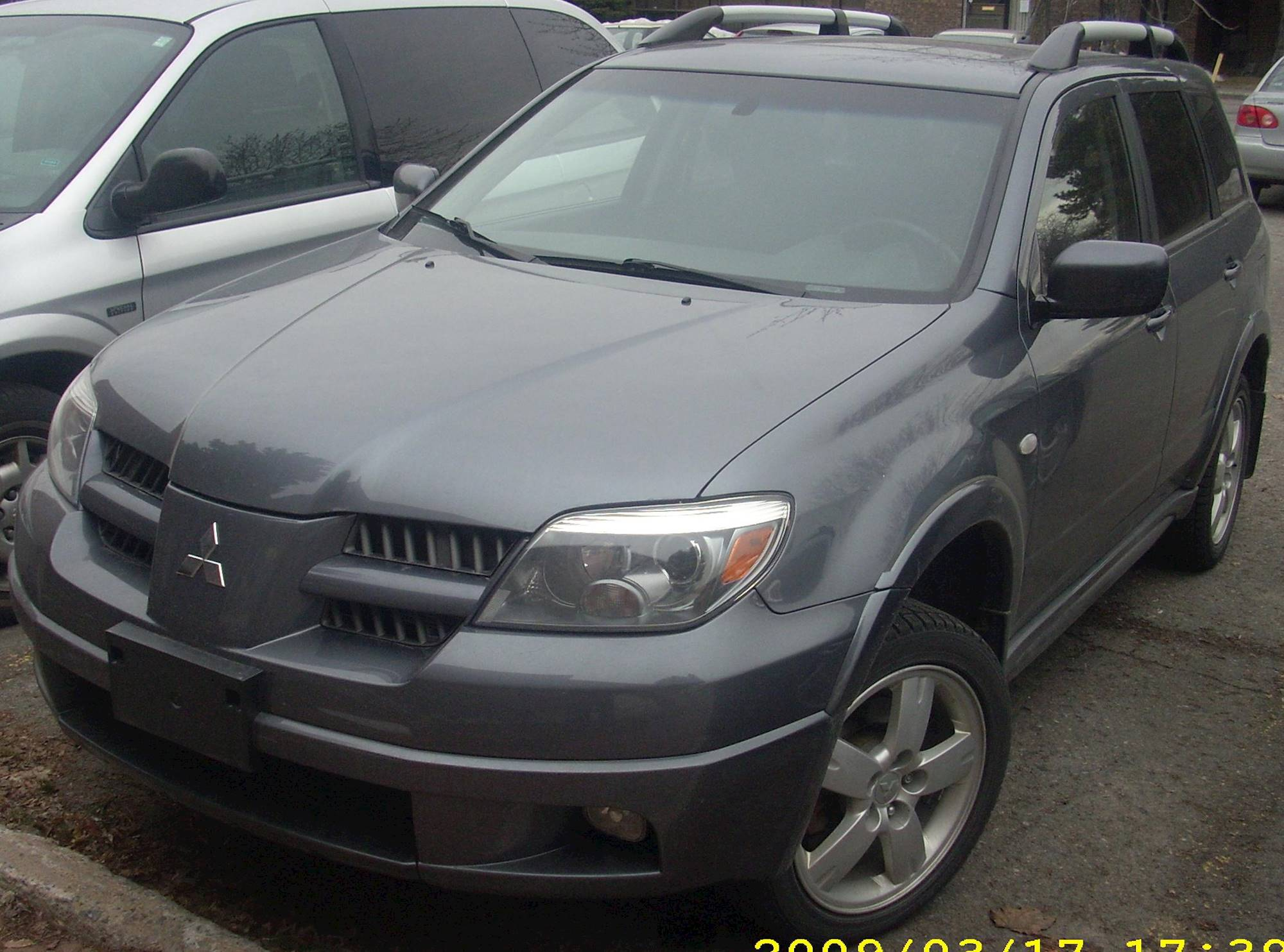 2006 mitsubishi outlander ls 4dr suv 2 4l awd auto. Black Bedroom Furniture Sets. Home Design Ideas